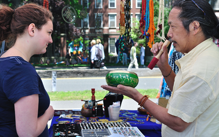 Local vendor demonstrating meditation bowl.
