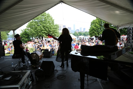 A band performing to a crowd at River Festival