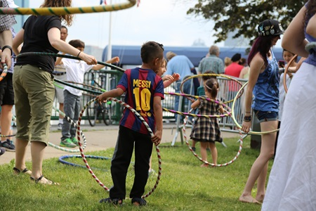 Attendees hula-hooping at River Festival