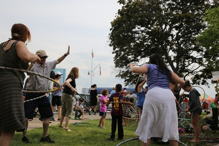 A group of attendees hula-hooping at River Festival