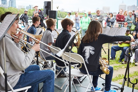 The Cambridge Rindge school band plays to a crowd