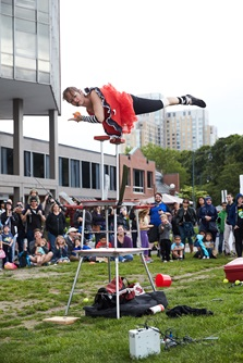 A performing artist displays an incredible acrobatic trick to a crowd