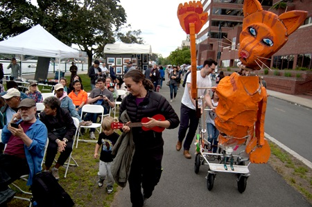 Walking a sculpture back to the finish line after the People's Sculpture Race