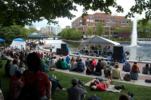Bands play on the floating stage in the Lechmere Canal during the 2017 River Festival.