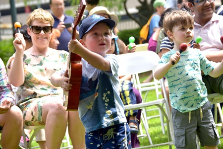 Children play music along with the band Little Groove on 2018 River Festival's Youth & Family Stage.