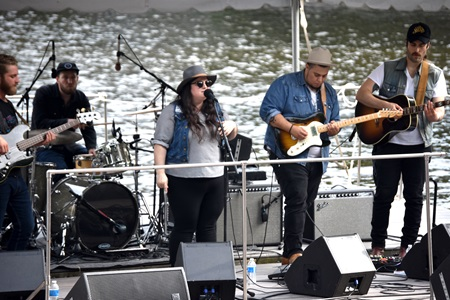 Julie Rhodes performs on the Rock, Indie, Alternative Stage floating in the Lechmere Canal at the 2018 River Festival.