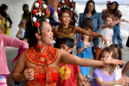 Boston Cendrawasih invites the audience onto the Interactive Dance Stage to learn the dance of Bali, Java and Sumatra at the 2019 Cambridge Arts River Festival.