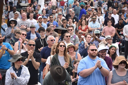 The audience claps along with the Kevin Harris Project at the Jazz, R&B, & World Music Stage during the 2019 Cambridge Arts River Festival.