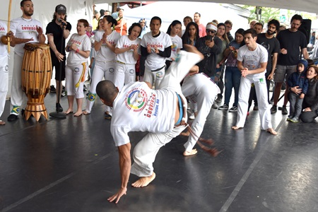 Mandinguerios dos Palmares Capoeira demonstrate the Brazilian mix of martial arts, dance and music on the Interactive Dance Stage at the 2019 Cambridge Arts River Festival.