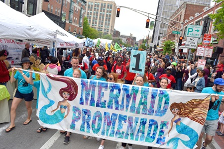 The Mermaid Promenade proceeds down Massachusetts Avenue during the 2019 Cambridge Arts River Festival.