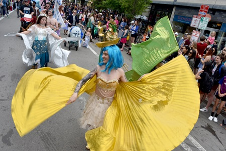 Moonrise Fae dance down Massachusetts Avenue during the Mermaid Promenade at the 2019 Cambridge Arts River Festival.