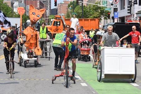 The People's Sculpture Race heads down Massachusetts Avenue to open the 2019 Cambridge Arts River Festival.