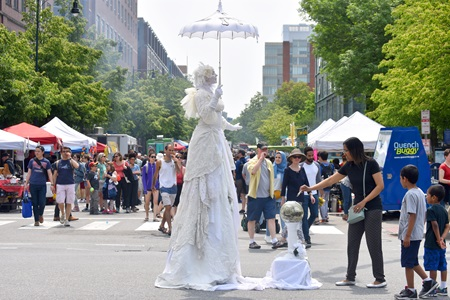 Snow, Living Statue performs on Massachusetts Avenue during the 2019 Cambridge Arts River Festival.