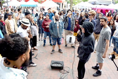The Bridgeside Cypher hip hop collective performs at Graffiti Alley during the 2019 Cambridge Arts River Festival.