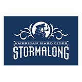"On top of a blue background is a silhouette of a sea captain, complete with cap and smoking pipe. Underneath the silhouette it says ""American Hard Cider"" and underneath that it says, in larger font, ""Stormalong"""