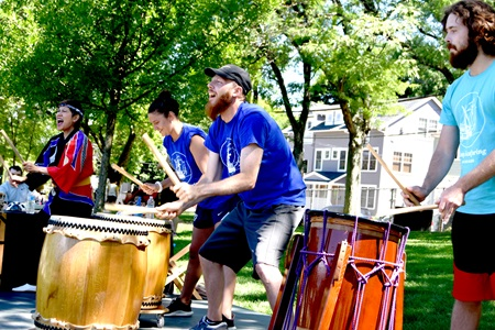 Audience members join Odaiko New England for drumming at Raymond Park as part of Cambridge Arts'