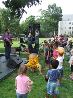 Rolie Polie Guacamole perform for a crowd of youngsters and families during Summer in the City in Cambridge.