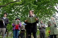 "Singers perform Andy Graydon's ""Gathering Note (a facsimile)"" on Cambridge Common, May 13, 2017."