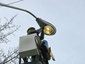 Worker repairing a street light