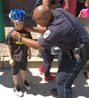 Officer Gives Child Bicycle Helmet