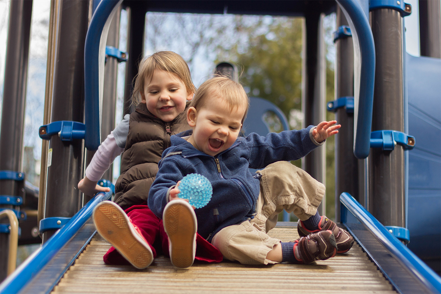 Photo of kids playing at a playground