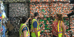 DPW workers in front of cans ready for recycling