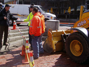 DPW Sidewalk crew discuss work to be done