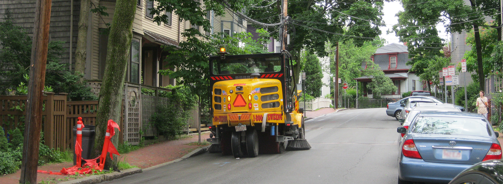 Street Sweeper cleaning roadway