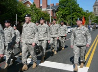 Veterans march in a Memorial Day parade