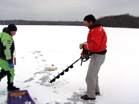 CWD staff member prepares to drill a hole in the ice.
