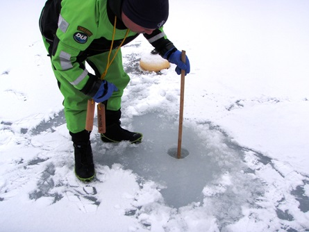 CFD staff measures the depth of the ice sheet. During this event, the ice depth ranged from 12-14 inches, with one fracture measuring 8 inches deep.