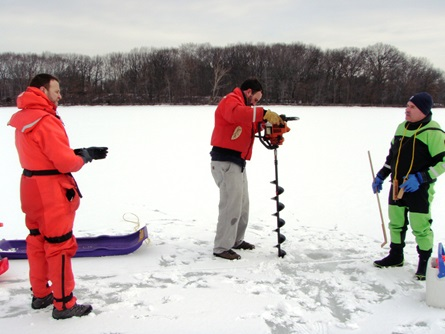 Drilling through the ice to access the water underneath for a temperature and dissolved oxygen profile.