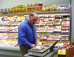 Checking the net weight of prepackaged meats