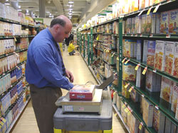 Conducting an audit inspection of retail packages to verify labeled net weight
